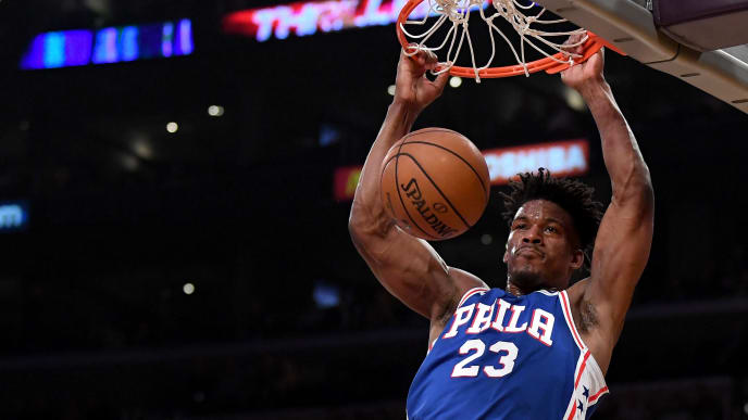 LOS ANGELES, CALIFORNIA - JANUARY 29:  Jimmy Butler #23 of the Philadelphia 76ers dunks in front of Rajon Rondo #9 of the Los Angeles Lakers during the first half at Staples Center on January 29, 2019 in Los Angeles, California.  NOTE TO USER: User expressly acknowledges and agrees that, by downloading and or using this photograph, User is consenting to the terms and conditions of the Getty Images License Agreement.  (Photo by Harry How/Getty Images)