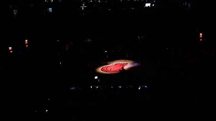 MIAMI, FL - APRIL 21: A spotlight view of the Miami Heat logo during introductions before Game Four of Round One of the 2018 NBA Playoffs between the Miami Heat and the Philadelphia 76ers at American Airlines Arena on April 21, 2018 in Miami, Florida. NOTE TO USER: User expressly acknowledges and agrees that, by downloading and or using this photograph, User is consenting to the terms and conditions of the Getty Images License Agreement. (Photo by Mark Brown/Getty Images) *** Local Caption ***