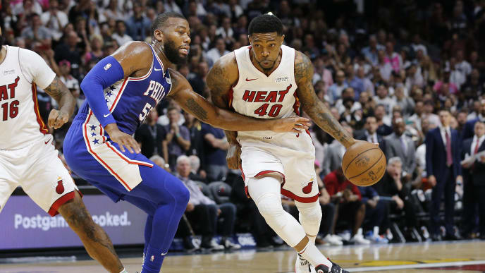 MIAMI, FLORIDA - APRIL 09: Udonis Haslem #40 of the Miami Heat drives to the basket against Greg Monroe #55 of the Philadelphia 76ers during the second half at American Airlines Arena on April 09, 2019 in Miami, Florida. NOTE TO USER: User expressly acknowledges and agrees that, by downloading and or using this photograph, User is consenting to the terms and conditions of the Getty Images License Agreement.  (Photo by Michael Reaves/Getty Images)