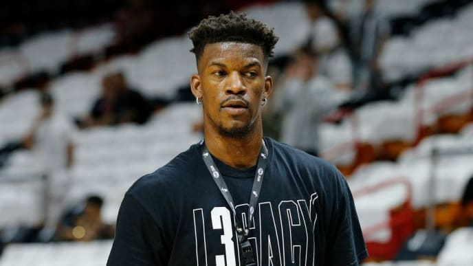 """MIAMI, FLORIDA - APRIL 09:  Jimmy Butler #23 of the Philadelphia 76ers warms up wearing a """"L3gacy"""" shirt to honor Dwyane Wade #3 of the Miami Heat (not pictured) as he plays his final regular season home game of his career at American Airlines Arena on April 09, 2019 in Miami, Florida. NOTE TO USER: User expressly acknowledges and agrees that, by downloading and or using this photograph, User is consenting to the terms and conditions of the Getty Images License Agreement.  (Photo by Michael Reaves/Getty Images)"""