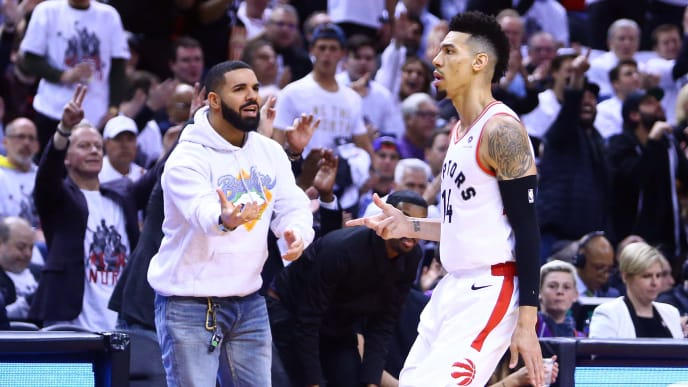 TORONTO, ON - MAY 07:  Singer Drake and Danny Green #14 of the Toronto Raptors celebrates a 3 pointer in the second half during Game Five of the second round of the 2019 NBA Playoffs against the Philadelphia 76ers at Scotiabank Arena on May 7, 2019 in Toronto, Canada.  NOTE TO USER: User expressly acknowledges and agrees that, by downloading and or using this photograph, User is consenting to the terms and conditions of the Getty Images License Agreement.  (Photo by Vaughn Ridley/Getty Images)