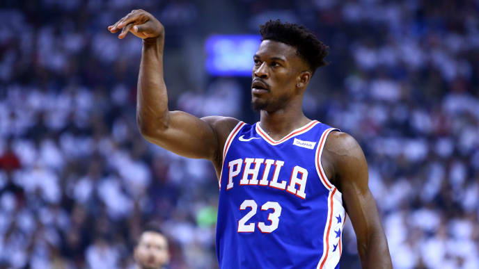 ]TORONTO, ON - MAY 07:  Jimmy Butler #23 of the Philadelphia 76ers gestures during Game Five of the second round of the 2019 NBA Playoffs against the Toronto Raptors at Scotiabank Arena on May 7, 2019 in Toronto, Canada.  NOTE TO USER: User expressly acknowledges and agrees that, by downloading and or using this photograph, User is consenting to the terms and conditions of the Getty Images License Agreement.  (Photo by Vaughn Ridley/Getty Images)