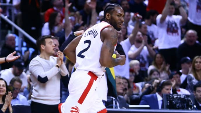 TORONTO, ON - APRIL 27:  Kawhi Leonard #2 of the Toronto Raptors reacts as he runs down the court during Game One of the second round of the 2019 NBA Playoffs against the Philadelphia 76ers at Scotiabank Arena on April 27, 2019 in Toronto, Canada.  NOTE TO USER: User expressly acknowledges and agrees that, by downloading and or using this photograph, User is consenting to the terms and conditions of the Getty Images License Agreement.  (Photo by Vaughn Ridley/Getty Images)