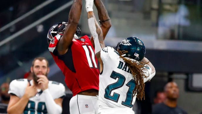 ATLANTA, GA - SEPTEMBER 15: Julio Jones #11 of the Atlanta Falcons makes a reception over Ronald Darby #21 of the Philadelphia Eagles in the first half of an NFL game at Mercedes-Benz Stadium on September 15, 2019 in Atlanta, Georgia. (Photo by Todd Kirkland/Getty Images)