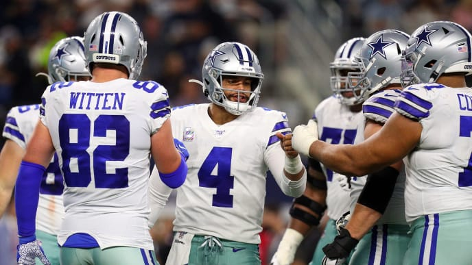 ARLINGTON, TEXAS - OCTOBER 20: Dak Prescott #4 of the Dallas Cowboys fist bumps teammates in the huddle during the game against the Philadelphia Eagles at AT&T Stadium on October 20, 2019 in Arlington, Texas. (Photo by Richard Rodriguez/Getty Images)
