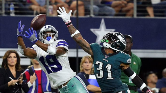 ARLINGTON, TEXAS - OCTOBER 20: Amari Cooper #19 of the Dallas Cowboys catches a pass against Jalen Mills #31 of the Philadelphia Eagles in the the fourth quarter at AT&T Stadium on October 20, 2019 in Arlington, Texas. (Photo by Richard Rodriguez/Getty Images)