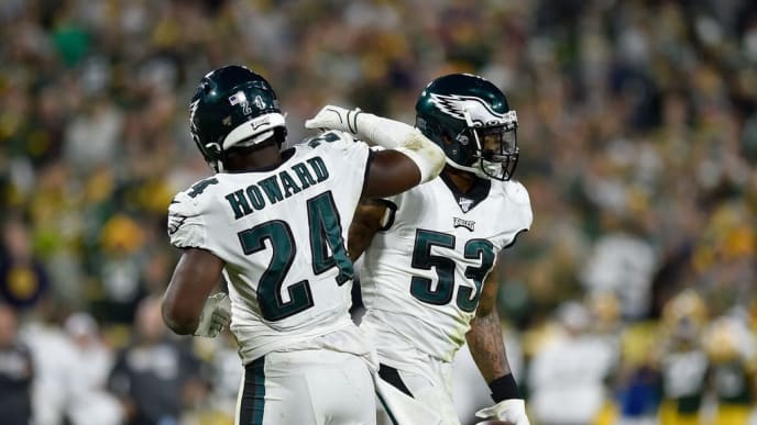 GREEN BAY, WISCONSIN - SEPTEMBER 26: Nigel Bradham #53 and Jordan Howard #24 of the Philadelphia Eagles celebrate after the interception in the fourth quarter against the Green Bay Packers at Lambeau Field on September 26, 2019 in Green Bay, Wisconsin. (Photo by Quinn Harris/Getty Images)
