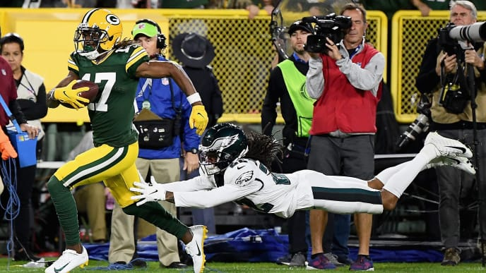 GREEN BAY, WISCONSIN - SEPTEMBER 26: Wide receiver Davante Adams #17 of the Green Bay Packers makes a 58 yard catch over the defense of  Sidney Jones #22 of the Philadelphia Eagles in the first quarter of the game at Lambeau Field on September 26, 2019 in Green Bay, Wisconsin. (Photo by Stacy Revere/Getty Images)