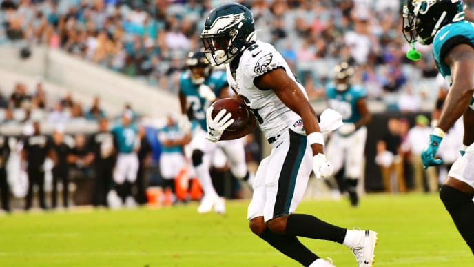 JACKSONVILLE, FLORIDA - AUGUST 15: Greg Ward #6 of the Philadelphia Eagles scores a touchdown after catching a 38-yard pass thrown by teammate Clayton Thorson #8 in the second quarter of a preseason football game against the Jacksonville Jaguars at TIAA Bank Field on August 15, 2019 in Jacksonville, Florida. (Photo by Julio Aguilar/Getty Images)