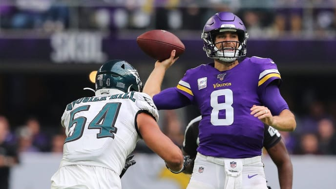 MINNEAPOLIS, MN - OCTOBER 13: Kirk Cousins #8 of the Minnesota Vikings throws a pass for a first down in the fourth quarter while Kamu Grugier-Hill #54 of the Philadelphia Eagles apples pressure at U.S. Bank Stadium on October 13, 2019 in Minneapolis, Minnesota. The Minnesota Vikings defeated the Philadelphia Eagles 38-20.(Photo by Adam Bettcher/Getty Images)