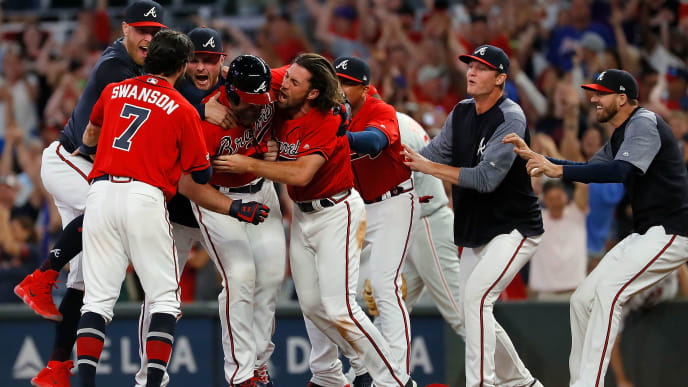 ATLANTA, GEORGIA - JUNE 14:  Brian McCann #16 of the Atlanta Braves reacts after hitting a walk-off single to score two runs to give the Braves a 9-8 win over the Philadelphia Phillies at SunTrust Park on June 14, 2019 in Atlanta, Georgia. (Photo by Kevin C. Cox/Getty Images)