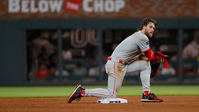 ATLANTA, GEORGIA - JULY 04:  Bryce Harper #3 of the Philadelphia Phillies kneels on second base during a pitching change by the Atlanta Braves in the fifth inning at SunTrust Park on July 04, 2019 in Atlanta, Georgia. (Photo by Kevin C. Cox/Getty Images)
