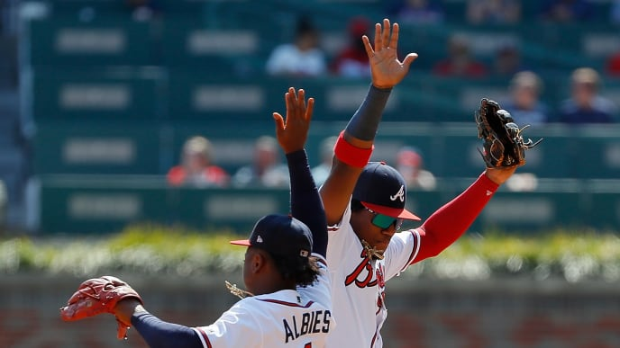 ATLANTA, GEORGIA - SEPTEMBER 19:  Ozzie Albies #1 and Ronald Acuna Jr. #13 of the Atlanta Braves celebrate after their 5-4 win over the Philadelphia Phillies at SunTrust Park on September 19, 2019 in Atlanta, Georgia. (Photo by Kevin C. Cox/Getty Images)