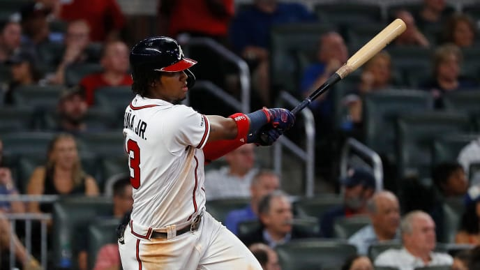 ATLANTA, GEORGIA - SEPTEMBER 18:  Ronald Acuna Jr. #13 of the Atlanta Braves hits a single in the seventh inning against the Philadelphia Phillies at SunTrust Park on September 18, 2019 in Atlanta, Georgia. (Photo by Kevin C. Cox/Getty Images)