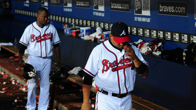 ATLANTA - SEPTEMBER 28: Alex Gonzalez #2 of the Atlanta Braves leaves the dugout after the game against the Philadelphia Phillies at Turner Field on September 28, 2011 in Atlanta, Georgia. (Photo by Scott Cunningham/Getty Images)