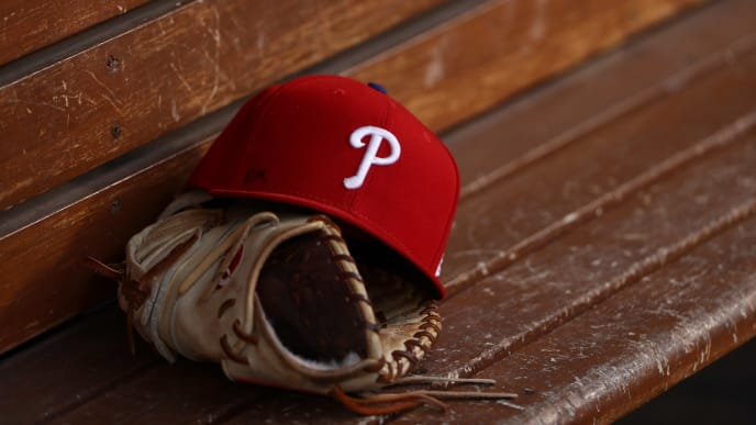 LOS ANGELES, CALIFORNIA - JUNE 01: A detailed view of a glove and Philadelphia Phillies hat is seen in the dugout prior to the MLB game between the Philadelphia Phillies and the Los Angeles Dodgers at Dodger Stadium on June 01, 2019 in Los Angeles, California. The Dodgers defeated the Phillies 4-3. (Photo by Victor Decolongon/Getty Images)