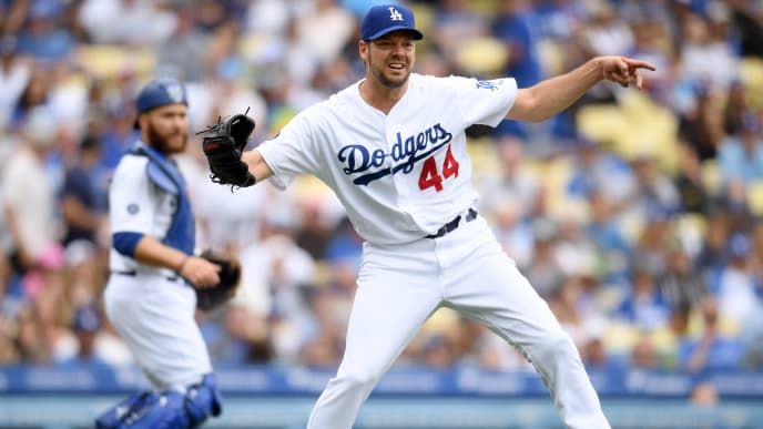 LOS ANGELES, CALIFORNIA - JUNE 02:  Rich Hill #44 of the Los Angeles Dodgers reacts as he throws out Jean Segura #2 of the Philadelphia Phillies, off of a bunt, during the sixth inning at Dodger Stadium on June 02, 2019 in Los Angeles, California. (Photo by Harry How/Getty Images)