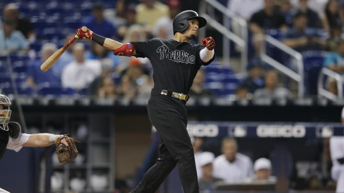 MIAMI, FLORIDA - AUGUST 25:  Cesar Hernandez #16 of the Philadelphia Phillies singles in the sixth inning against the Miami Marlins at Marlins Park on August 25, 2019 in Miami, Florida. Teams are wearing special color schemed uniforms with players choosing nicknames to display for Players' Weekend. (Photo by Michael Reaves/Getty Images)