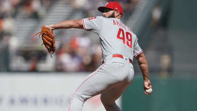 SAN FRANCISCO, CA - AUGUST 11:  Jake Arrieta #49 of the Philadelphia Phillies pitches against the San Francisco Giants in the bottom of the first inning at Oracle Park on August 11, 2019 in San Francisco, California.  (Photo by Thearon W. Henderson/Getty Images)