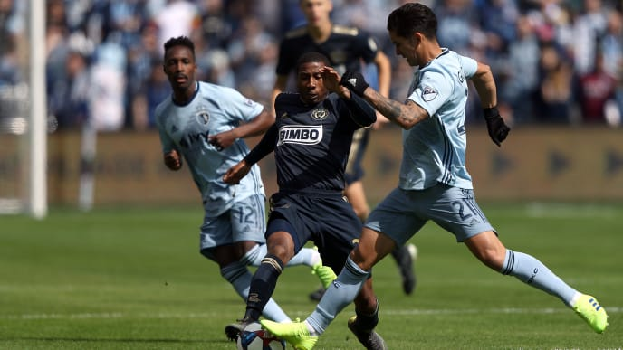 KANSAS CITY, KANSAS - MARCH 10:  Auston Trusty #26 of Philadelphia Union and Felipe Gutierrez #21 of Sporting Kansas City compete for the ball during the game at Children's Mercy Park on March 10, 2019 in Kansas City, Kansas. (Photo by Jamie Squire/Getty Images)