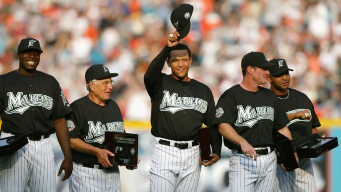 MIAMI - APRIL 10:  (L-R) Dontrelle Willis #35, Manager Jack McKeon #15, Miguel Cabrera #24, Jeff Conine #18 and Alex Gonzalez #11 of the Florida Marlins smile and acknowledge the fans after receiving their 2003 World Series Championship rings prior to the game against the Philadelphia Phillies at Pro Player Stadium on April 10, 2004 in Miami, Florida. The Marlins won 5-3.  (Photo by Victor Baldizon/Getty Images)
