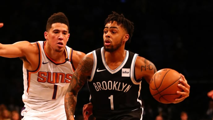 NEW YORK, NY - OCTOBER 31:  D'Angelo Russell #1 of the Brooklyn Nets dribbles against Devin Booker #1 of the Phoenix Suns during their game at Barclays Center on October 31, 2017 in the Brooklyn Borough of New York City.  User expressly acknowledges and agrees that, by downloading and/or using this Photograph, user is consenting to the terms and conditions of the Getty Images License Agreement.  (Photo by Al Bello/Getty Images)