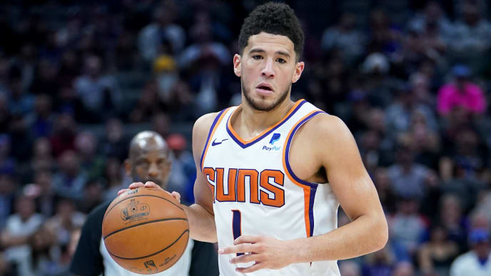 SACRAMENTO, CALIFORNIA - NOVEMBER 19: Devin Booker #1 of the Phoenix Suns dribbles the ball up court against the Sacramento Kings during the second half of an NBA basketball game at Golden 1 Center on November 19, 2019 in Sacramento, California. NOTE TO USER: User expressly acknowledges and agrees that, by downloading and or using this photograph, User is consenting to the terms and conditions of the Getty Images License Agreement. (Photo by Thearon W. Henderson/Getty Images)