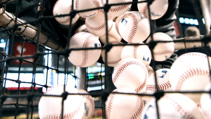 PHOENIX, ARIZONA - MAY 14:  Clubhouse manager Scott Bonnett of the Pittsburgh Pirates dumps a bag of baseballs into the batting practice basket prior to a game against the Arizona Diamondbacks at Chase Field on May 14, 2019 in Phoenix, Arizona. (Photo by Norm Hall/Getty Images)