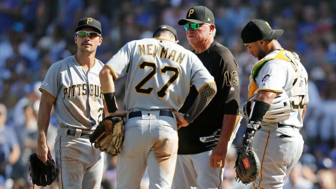 CHICAGO, ILLINOIS - SEPTEMBER 14: Manager Clint Hurdle #13 of the Pittsburgh Pirates visits the mound for a pitching change during the fifth inning of a game against the Chicago Cubs at Wrigley Field on September 14, 2019 in Chicago, Illinois. (Photo by Nuccio DiNuzzo/Getty Images)