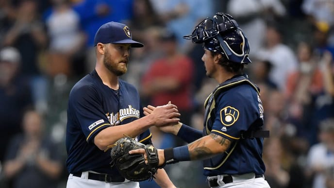 MILWAUKEE, WISCONSIN - SEPTEMBER 21: Jimmy Nelson #52 of the Milwaukee Brewers and JJacob Nottingham #26 of the Milwaukee Brewers celebrate the 10-1 victory against the Pittsburgh Pirates at Miller Park on September 21, 2019 in Milwaukee, Wisconsin. (Photo by Quinn Harris/Getty Images)