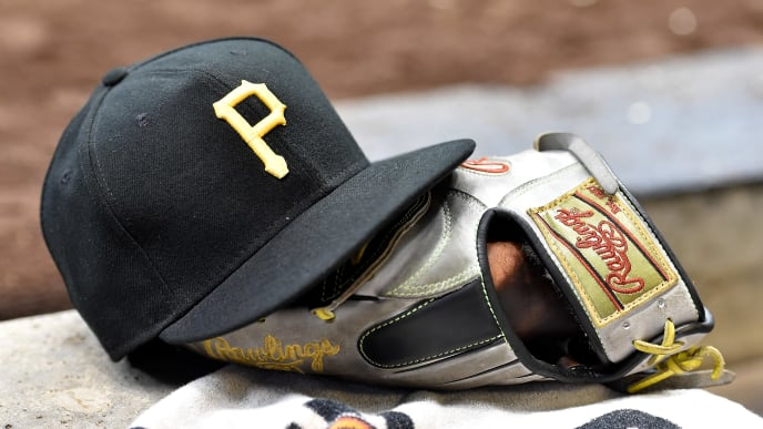 MILWAUKEE, WISCONSIN - SEPTEMBER 21: A detail view of a Pittsburgh Pirates baseball cap and a Rawlings baseball glove during the game against the Milwaukee Brewers at Miller Park on September 21, 2019 in Milwaukee, Wisconsin. (Photo by Quinn Harris/Getty Images)