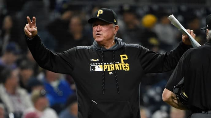 SAN DIEGO, CA - MAY 16: Clint Hurdle #13 of the Pittsburgh Pirates gestures as he comes onto the field after making a pitching change during the fourth inning of a baseball game against the San Diego Padres at Petco Park May 16, 2019 in San Diego, California.  (Photo by Denis Poroy/Getty Images)