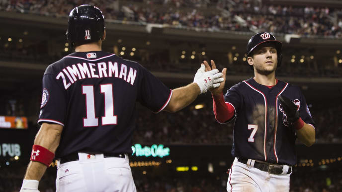 WASHINGTON, DC - SEPTEMBER 29: Trea Turner #7 of the Washington Nationals celebrates with Ryan Zimmerman #11 after scoring on a single hit by Daniel Murphy #20 (not pictured) in the sixth inning against the Pittsburgh Pirates at Nationals Park on September 29, 2017 in Washington, DC. (Photo by Patrick McDermott/Getty Images)