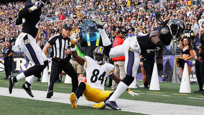 BALTIMORE, MD - DECEMBER 27:  Kendrick Lewis #23 of the Baltimore Ravens is called for pass interference after running into Jimmy Smith #22 of the Baltimore Ravens and  Antonio Brown #84 of the Pittsburgh Steelers at M&T Bank Stadium on December 27, 2015 in Baltimore, Maryland.  (Photo by Rob Carr/Getty Images)