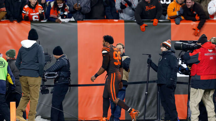 CLEVELAND, OH - NOVEMBER 14:  Myles Garrett #95 of the Cleveland Browns walks off of the field after being ejected for fighting at the end of the game against the Pittsburgh Steelers at FirstEnergy Stadium on November 14, 2019 in Cleveland, Ohio. Cleveland defeated Pittsburgh 21-7. (Photo by Kirk Irwin/Getty Images)