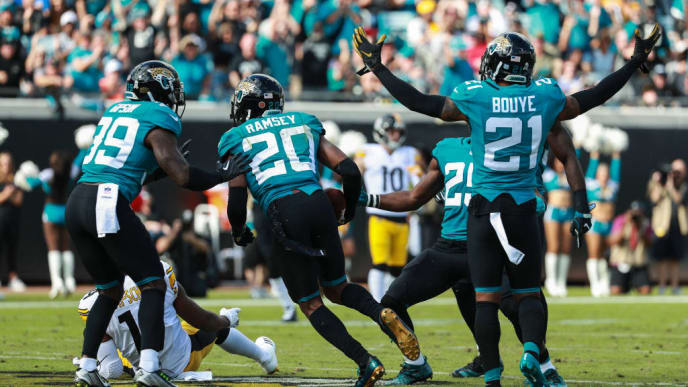 JACKSONVILLE, FL - NOVEMBER 18: Members of the Jacksonville Jaguars defense celebrate the interception made by Jalen Ramsey #20 of the Jacksonville Jaguars during the first half against the Pittsburgh Steelers at TIAA Bank Field on November 18, 2018 in Jacksonville, Florida.  (Photo by Scott Halleran/Getty Images)