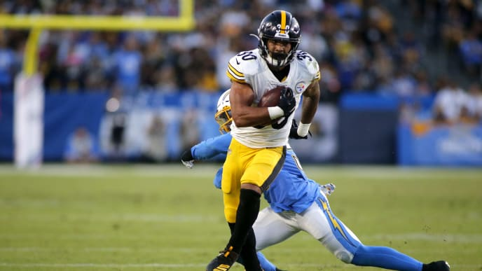 CARSON, CALIFORNIA - OCTOBER 13:  Running back James Conner #30 of the Pittsburgh Steelers breaks through a tackle by outside linebacker Jatavis Brown #57 of the Los Angeles Chargers for a touchdown in the second quarter at Dignity Health Sports Park on October 13, 2019 in Carson, California. (Photo by Katharine Lotze/Getty Images)