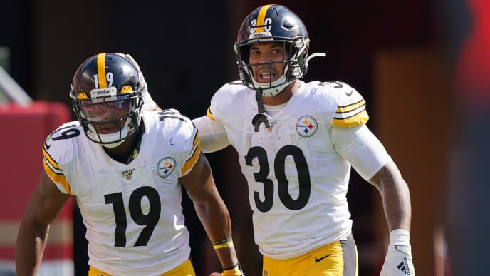 SANTA CLARA, CALIFORNIA - SEPTEMBER 22: JuJu Smith-Schuster #19 and James Conner #30 of the Pittsburgh Steelers celebrates after Smith-Schuster caught a pass and broke away for a 76 yard touchdown play against the San Francisco 49ers during the third quarter of an NFL football game at Levi's Stadium on September 22, 2019 in Santa Clara, California. (Photo by Thearon W. Henderson/Getty Images)
