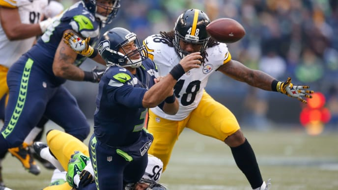 SEATTLE, WA - NOVEMBER 29:  Quarterback Russell Wilson #3 of the Seattle Seahawks is sacked by linebacker Jarvis Jones #95 of the Pittsburgh Steelers in the second quarter at CenturyLink Field on November 29, 2015 in Seattle, Washington.  (Photo by Otto Greule Jr/Getty Images)