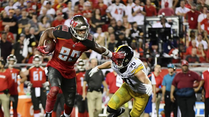 TAMPA, FL - SEPTEMBER 24: O.J. Howard #80 of the Tampa Bay Buccaneers breaks a tackle from T.J. Watt #90 of the Pittsburgh Steelers in the fourth quarter on September 24, 2018 at Raymond James Stadium in Tampa, Florida. (Photo by Julio Aguilar/Getty Images)