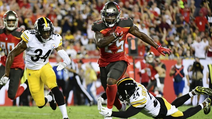 TAMPA, FL - SEPTEMBER 24: Peyton Barber #25 of the Tampa Bay Buccaneers runs for 18 yards to set up a touchdown in the firs quarter against the Pittsburgh Steelers on September 24, 2018 at Raymond James Stadium in Tampa, Florida. (Photo by Julio Aguilar/Getty Images)