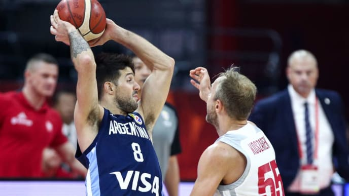 FOSHAN, CHINA - SEPTEMBER 08: #8 Nicolas Laprovittola of the Argentina National Team in action against #55 Lukasz Koszarek of the Poland National Team during the 2nd round of 2019 FIBA World Cup at GBA International Sports and Cultural Center on September 8, 2019 in Foshan, China. (Photo by Zhong Zhi/Getty Images)