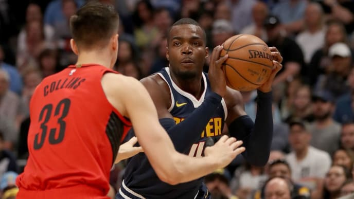 DENVER, COLORADO - MAY 12: Paul Millsap #4 of the Denver Nuggets is guarded by Zach Collins #33 of the Portland Trail Blazers in the first quarter during Game Seven of the Western Conference Semi-Finals of the 2019 NBA Playoffs at the Pepsi Center on May 12, 2019 in Denver, Colorado. NOTE TO USER: User expressly acknowledges and agrees that, by downloading and or using this photograph, User is consenting to the terms and conditions of the Getty Images License Agreement. (Photo by Matthew Stockman/Getty Images)