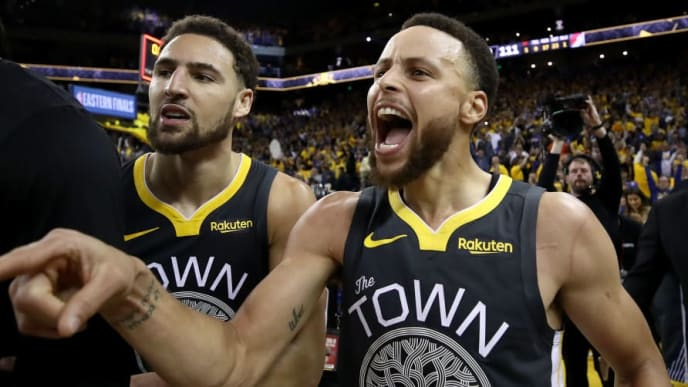 OAKLAND, CALIFORNIA - MAY 16: Stephen Curry #30 and Klay Thompson #11 of the Golden State Warriors celebrate after defeating the Portland Trail Blazers 114-111 in game two of the NBA Western Conference Finals at ORACLE Arena on May 16, 2019 in Oakland, California. NOTE TO USER: User expressly acknowledges and agrees that, by downloading and or using this photograph, User is consenting to the terms and conditions of the Getty Images License Agreement. (Photo by Ezra Shaw/Getty Images)