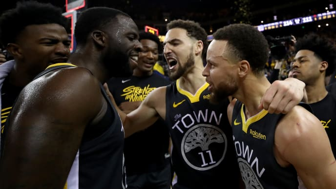 OAKLAND, CALIFORNIA - MAY 16: Stephen Curry #30, Klay Thompson #11 and Draymond Green #23 of the Golden State Warriors celebrate after defeating the Portland Trail Blazers 114-111 in game two of the NBA Western Conference Finals at ORACLE Arena on May 16, 2019 in Oakland, California. NOTE TO USER: User expressly acknowledges and agrees that, by downloading and or using this photograph, User is consenting to the terms and conditions of the Getty Images License Agreement. (Photo by Ezra Shaw/Getty Images)