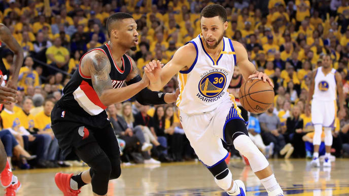 OAKLAND, CA - APRIL 19:  Stephen Curry #30 of the Golden State Warriors drives on Damian Lillard #0 of the Portland Trail Blazers Game Two of the Western Conference Quarterfinals during the 2017 NBA Playoffs at ORACLE Arena on April 19, 2017 in Oakland, California. NOTE TO USER: User expressly acknowledges and agrees that, by downloading and or using this photograph, User is consenting to the terms and conditions of the Getty Images License Agreement.  (Photo by Ezra Shaw/Getty Images)