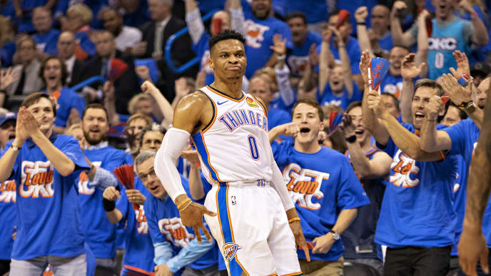 OKLAHOMA CITY, OK - APRIL 21: Russell Westbrook #0 of the Oklahoma City Thunder celebrates after making a three point shot during a game against the Portland Trail Blazers during Round One Game Three of the 2019 NBA Playoffs on April 21, 2019 at Chesapeake Energy Arena in Oklahoma City, Oklahoma  NOTE TO USER: User expressly acknowledges and agrees that, by downloading and or using this photograph, User is consenting to the terms and conditions of the Getty Images License Agreement.  (Photo by Wesley Hitt/Getty Images)