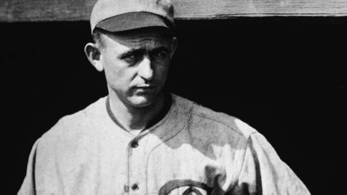 American professional baseball player pitcher Dickie Kerr (1893 - 1963) of the American League's Chicago White Sox stands in a home uniform with arms akimbo, Chicago, October 1919. Although on the infamous 'Black Sox' team Kerr was not involved in throwing the 1919 World Series. (Photo by APA/Getty Images)