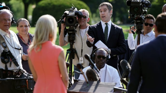 WASHINGTON, DC - JULY 02: NBC News White House Correspondent Peter Alexander questions Counselor to the President Kellyanne Conway outside the West Wing following her television interview with FOX News at the White House July 02, 2019 in Washington, DC. Conway berated reporters as they asked her about President Donald Trump's planned speech on the Fourth of July.  (Photo by Chip Somodevilla/Getty Images)