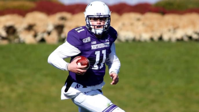EVANSTON, ILLINOIS - NOVEMBER 09: Aidan Smith #11 of the Northwestern Wildcats runs the ball  in the game against the Purdue Boilermakers at Ryan Field on November 09, 2019 in Evanston, Illinois. (Photo by Justin Casterline/Getty Images)